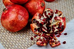 pomegranates on the table on a gray napkin on a linen tablecloth royalty free stock photos