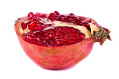 Pomegranates on white. Close up view of some pomegranate fruit  isolated on a white background Stock Images