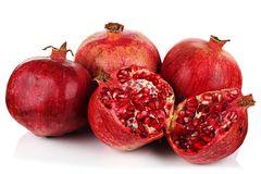 Pomegranates on a white background. Royalty Free Stock Images