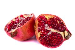 Pomegranates on white. Close up view of some pomegranate fruit   on a white background Stock Photos