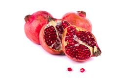 Pomegranates on white. Close up view of some pomegranate fruit   on a white background Stock Photo