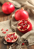 Pomegranates, whole and cut open Royalty Free Stock Image