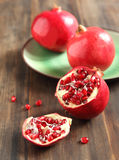 Pomegranates, whole and cut open Royalty Free Stock Images