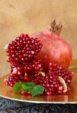 Pomegranates, whole and open Stock Photography