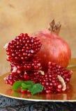 Pomegranates, whole and open Stock Photography