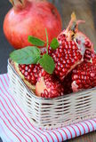 Pomegranates, whole and open Royalty Free Stock Images