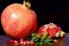 Pomegranates on wood background