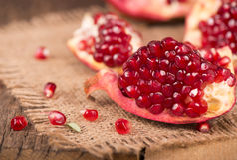 Pomegranates on a wooden background Stock Photo