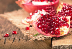 Pomegranates on a wooden background Stock Image