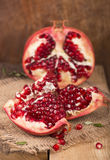 Pomegranates on a wooden background Stock Images