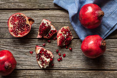 Pomegranates on wooden table Royalty Free Stock Image