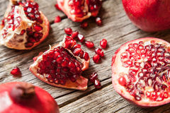 Pomegranates on wooden table Royalty Free Stock Photos