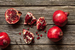 Pomegranates on wooden table Royalty Free Stock Photography