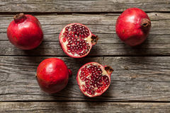 Pomegranates on wooden table Stock Images