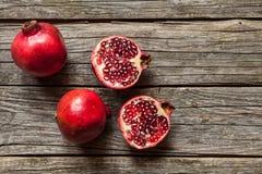 Pomegranates on wooden table Royalty Free Stock Photo