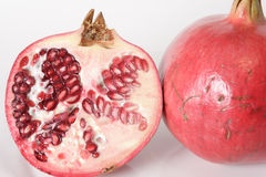 Pomegrante half and whole. Half and whole pomerante, ruby red in color Stock Photo