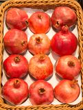 Pomegrantes on the basket. For sale Royalty Free Stock Images