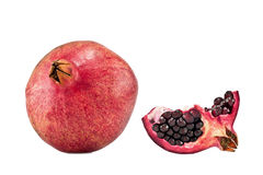 Pomegwhole and cut pomegranate. Whole and cut pomegranate fruit isolated on white background royalty free stock photography