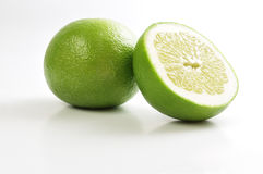 Pomelo. Isolated on white glossy background Stock Images
