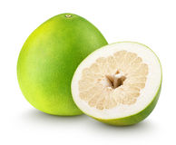 Pomelo citrus fruit with cut isolated on white. Green pomelo citrus fruit with cut isolated on white with clipping path royalty free stock photo