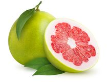 Pomelo citrus fruit isolated. Pomelo citrus fruit with leaves isolated on white background. Clipping path included stock images