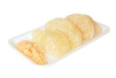 Pomelo citrus. On white foam plate Stock Photos