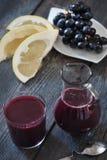 Pomelo e succo dell'uva Immagine Stock