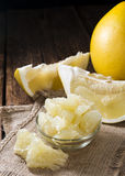 Pomelo Fruit. Pieces of a fresh Pomelo Fruit on wooden background Stock Images