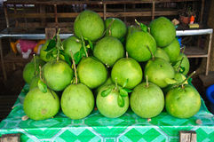 Pomelo fruit on shelves Royalty Free Stock Images
