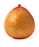 Pomelo fruit wrapped in red plastic reticle Royalty Free Stock Image