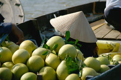 Pomelos at a floating market in South Vietnam Stock Images