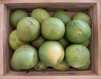 Pomelos in wood box Stock Photo
