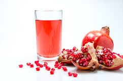 Pomepranate juice in glass royalty free stock photography