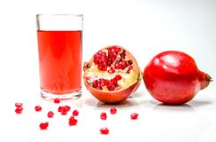 Pomepranate juice in glass stock photography