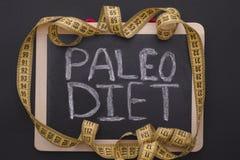 Pomiarowa taśma na blackboard z słowa Paleo dietą Zdjęcia Royalty Free