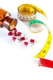 Pomiarowa taśma z kapsułą, Dieting medycyną Zdjęcia Stock
