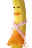 Pomiarowa taśma zawijająca wokoło banana w postaci dziewczyny, z jabłkiem, brokułami i marchewką, Pojęcie dieta Zdjęcie Stock