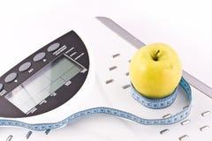 pomiarowi jabłko przedmioty Fotografia Stock