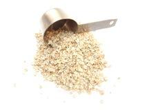 pomiarowy filiżanki oatmeal Fotografia Stock