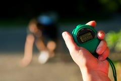 pomiarowy szybkobiegacza czas trener Zdjęcia Royalty Free