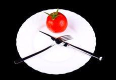 Pomidor w talerzu Zdjęcia Royalty Free