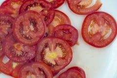 pomidorowi plasterki Obrazy Royalty Free