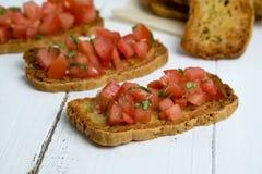 Pomidorowy bruschetta jedzenia closup Zdjęcia Stock