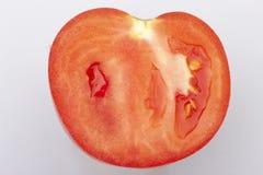 Pomidorowy plasterek na białym tle Może używać jako tło zdjęcia stock