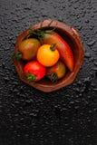 Pomidory i pieprz w pucharze Obrazy Royalty Free