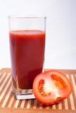 Pomidory i pomidorowy sok Fotografia Royalty Free