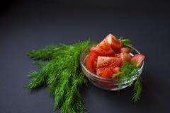 Pomidory i zielony koper obraz stock