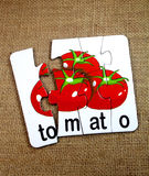 Pomidory w łamigłówce Obraz Stock