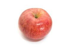 Pomme brillante D'isolement sur un fond blanc Photos stock