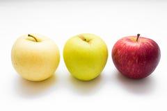 Pomme colorée par trois Photographie stock libre de droits